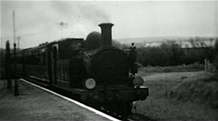 Steam locomotive arriving at a station on the Isle of Wight old B&W film Stock Footage