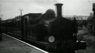 Stock Video Footage of Steam locomotive arriving at a station on the Isle of Wight old B&W film