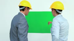Business people working on a poster Stock Footage