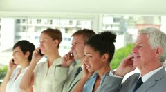 Business people of all ages smiling on the phone Stock Footage