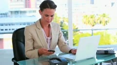 Businesswoman receiving a mobile phone call Stock Footage
