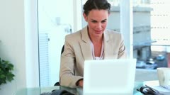 Happy woman working with laptop and picking up the phone Stock Footage