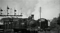 Steam locomotive leaving a station on the Isle of Wight old B&W film - stock footage