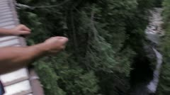Lynn Canyon Vancouver - Tossing penny off of bridge. Stock Footage