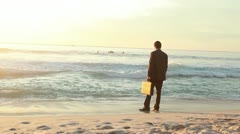 Businessman standing on the shore Stock Footage