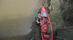 Stock Footage - Launching canoe into river - Overhead POV Stock Footage
