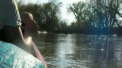 Stock Footage - Conoeing down a river - riding the current - pass tree in river Stock Footage