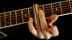 Finger play on guitar with slide Stock Footage
