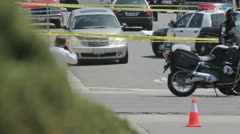 Crime Scene with a news photographer taking a picture in the foreground - stock footage