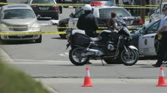 Crime Scene with police in the foreground controlling the scene. - stock footage