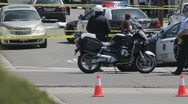 Crime Scene with police in the foreground controlling the scene. Stock Footage