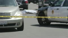 An out of focus dead body with crime scene tape in the foreground Stock Footage