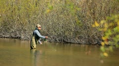 Man flyfishing for rainbow trout Stock Footage