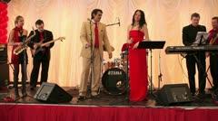 Singers and musicians perform at the restaurant Stock Footage