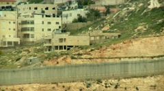Boarder Wall next to Arabic Village 2 Stock Footage