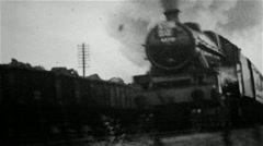 Steam locomotive hauling a passenger train in an old B&W film Stock Footage