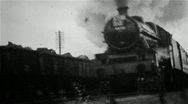 Stock Video Footage of Steam locomotive hauling a passenger train in an old B&W film