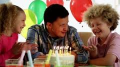 Older boy celebrating birthday - stock footage