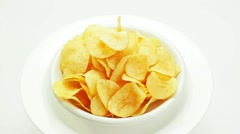 Potato chips heap rotating on a white plate - stock footage