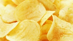 Rotating potato chips, macro view food background Stock Footage