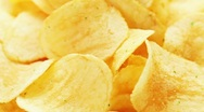 Stock Video Footage of Rotating potato chips, macro view food background