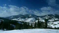 Time-lapse of clouds passing by over winter landscape in Carpathian Stock Footage