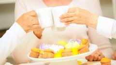Multi Ethnic Retired Girlfriends Enjoying Tea Cupcakes Stock Footage