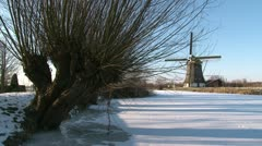 Old Dutch Windmill in Winter (two takes) - stock footage