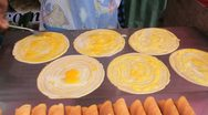 Street Vendor Makes Egg Crepes Stock Footage