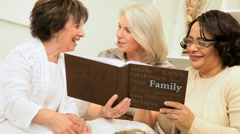 Stock Video Footage of Group Retired Girlfriends Looking Photo Album
