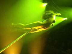 A ToplessFemale Stripper dances on a Pole Dancer (Partial Nudity) Stock Footage