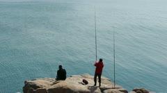 Man fishing on reef. Stock Footage