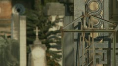 Rack focus gate to grave yard Stock Footage