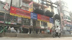 Banner 'Chinese business lessons' in the streets of Lahore, Pakistan - stock footage