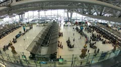Bangkok airport check-in counters crowded by passengers, timelapse, wide view - stock footage