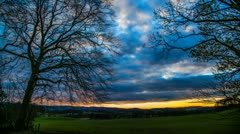Stock Video Footage of Scottish Cloudy Sunset Timelapse With Trees In Foreground