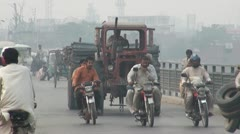 Variety of traffic on an old bridge in Lahore Stock Footage
