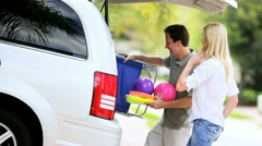 Young Family Packing Car for Beach Trip Stock Footage