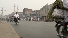 Standing in the middle of the road in downtown Lahore Stock Footage