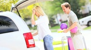 Blonde Parents Daughters Preparing Family Car Outing Stock Footage