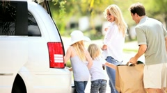 Young Caucasian Family Packing Car Before Outing Stock Footage
