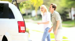 Young Caucasian Couple Preparing Car Weekend Outing Stock Footage