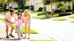 Stock Video Footage of Cute Blonde Girl Practicing Bike Riding