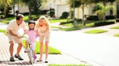 Cute Blonde Girl Practicing Bike Riding Stock Footage