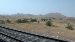 Riding a train through the deserts of Sindh province - stock footage