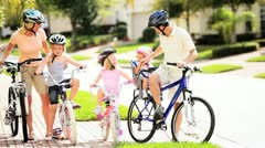 Young Caucasian Family Group Bicycles Outdoors  - stock footage