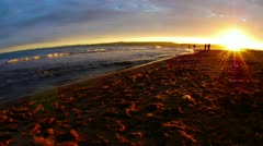 Time lapse of silhouetted children playing by the sea at sunset. Stock Footage