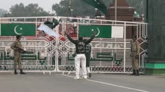 Waving flags at the Wagah border ceremony Stock Footage