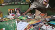 Buying second hand books on a market in Pakistan Stock Footage