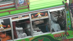 Closeup of an open bus driving off in Pakistan Stock Footage